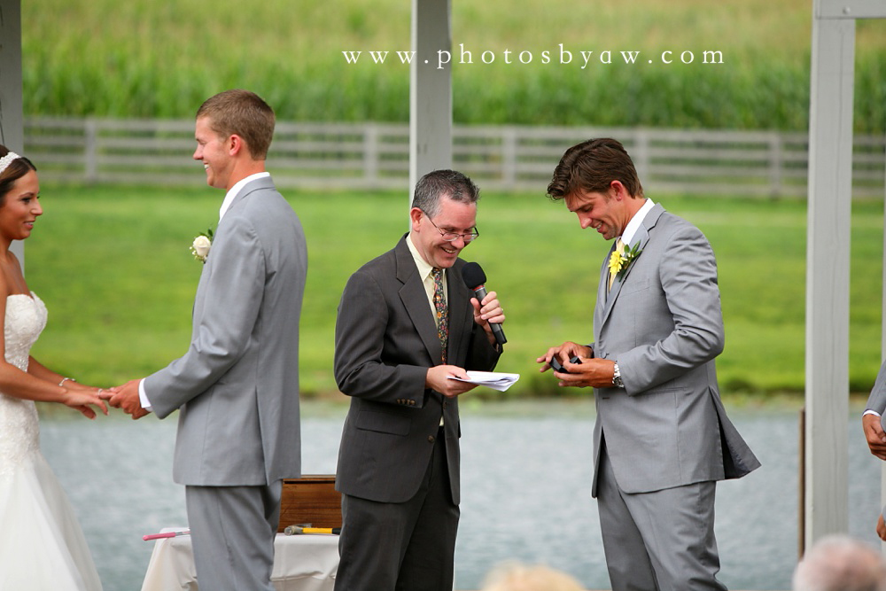 best_man_has_wedding_rings_outdoor_ceremony
