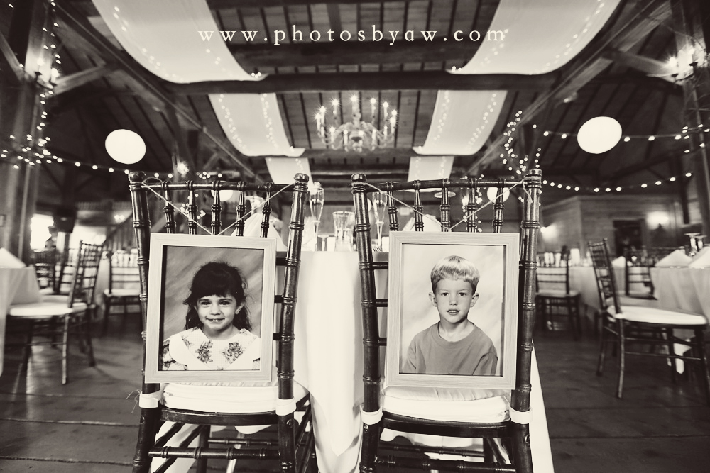 bride_and_groom_childhood_photos_on_backs_of_their_chairs